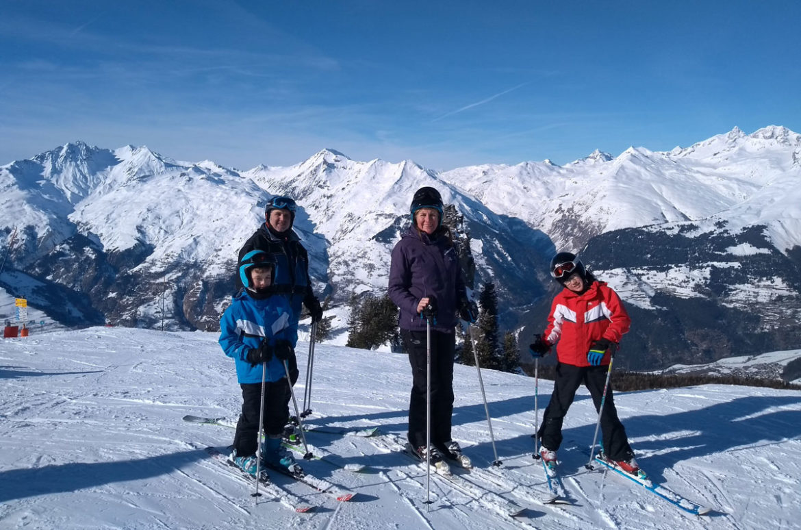 Family standing on skis at Arc 1800 in France