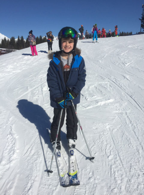 Boy on skis at Arc 1800 in France