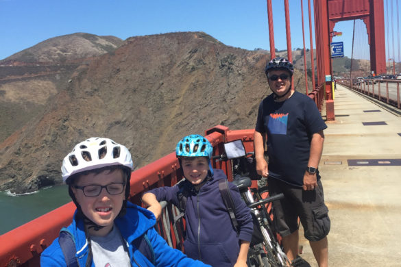 Family with bikes stopping half way across the Golden Gate Bridge, San Francisco