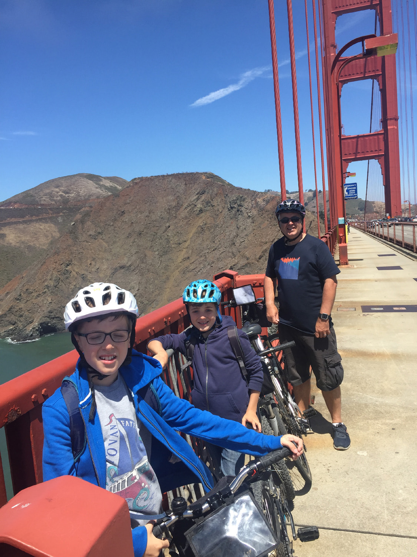 Family with bikes stopping half way across the Golden Gate Bridge, San Francisco