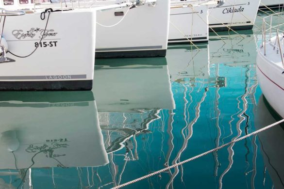 Split Harbour, view of boards and reflections in blue sea.