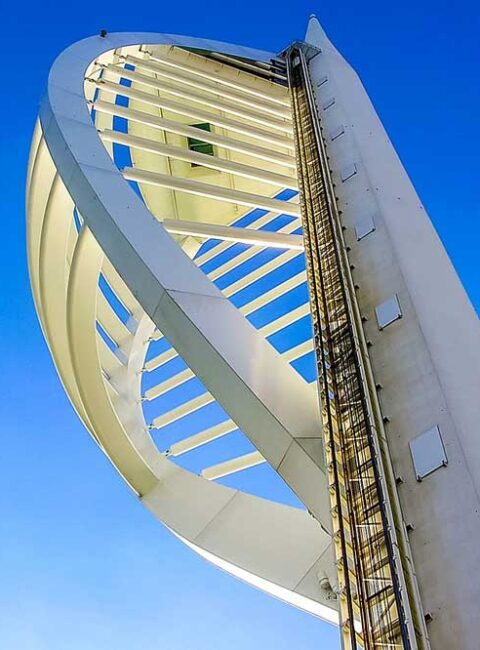 View looking up at Spinakker tower, Portsmouth framed in blue sky, Hampshire