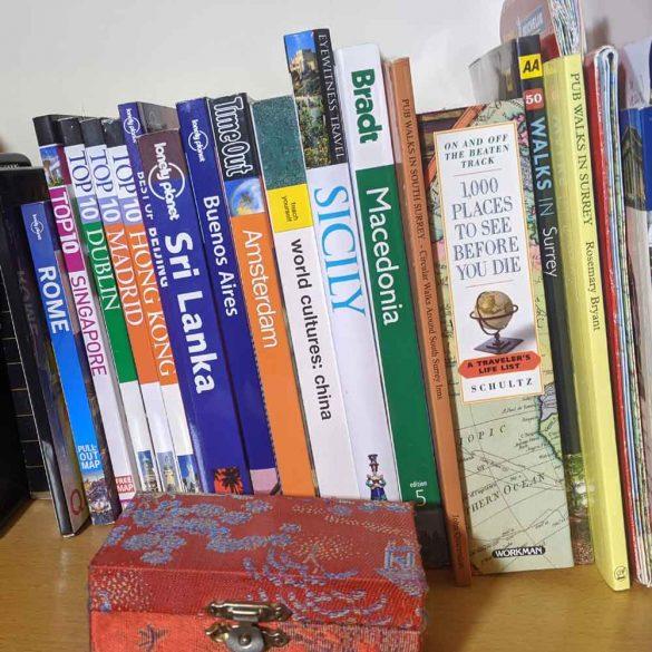 selection of travel books on shelf