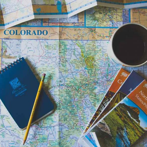 maps, notepad, coffee, planning a trip