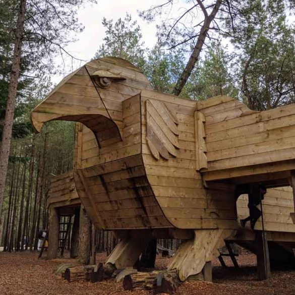 Large wooden play structure in shape of bird at Moors Valley country park