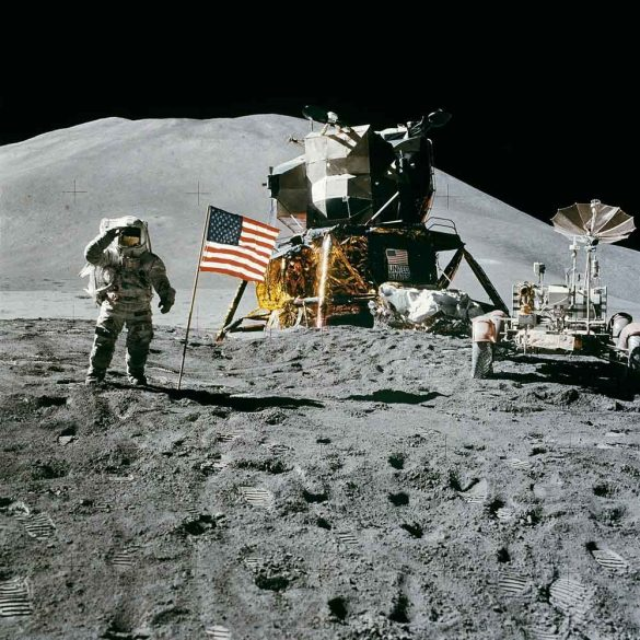 Image of astronaugh saluting to american flag on moon with lunar modual and lunar rover in background