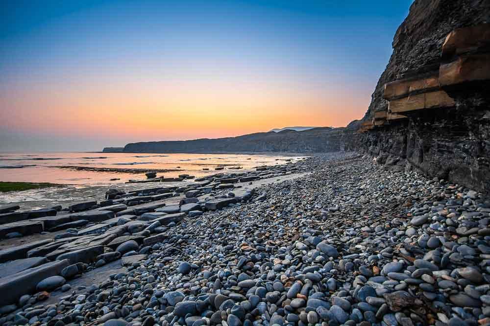 view of cliffs, stones and sea, Jurassic Coast, Dorset, England