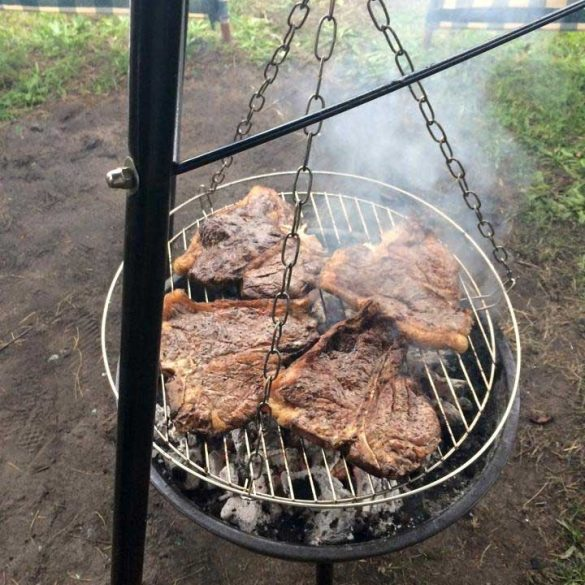 T-Bone Steaks cooking on Tripod Charcoal BBQ