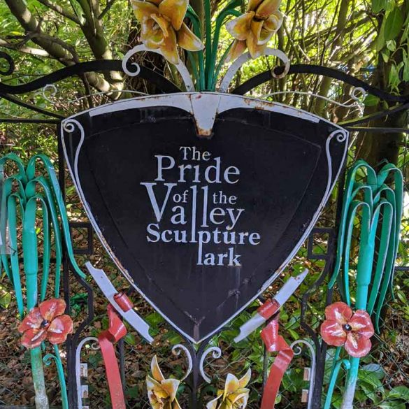 highly decorated metalwork sign for Pride of Valley Sculpture Park, Farnham, Surrey