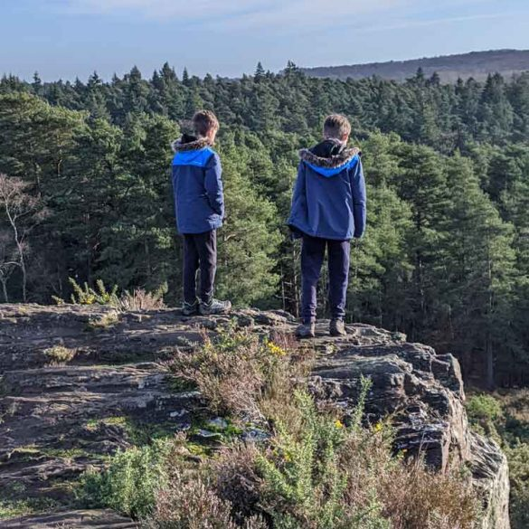 Two boys looking out at view from Devil's Jumps Hills
