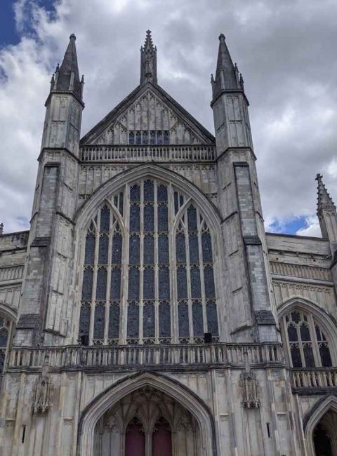 looking up at Winchester Cathedral stain glass windows