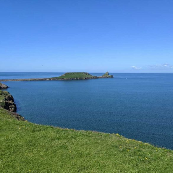 Views from Coastal Path across sea to Worms Head, Rhossili , Gower Peninsula