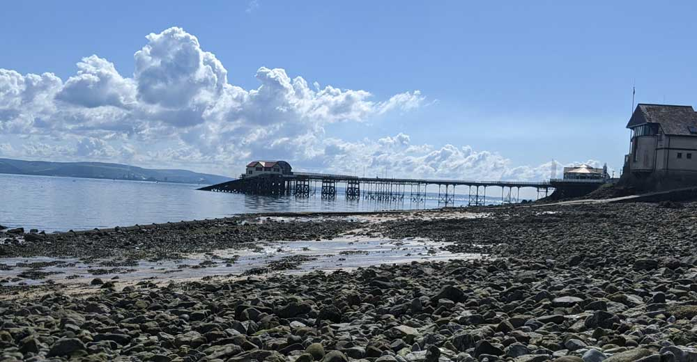View of Mumbles Pier over pebble beach, Gower Peninsula