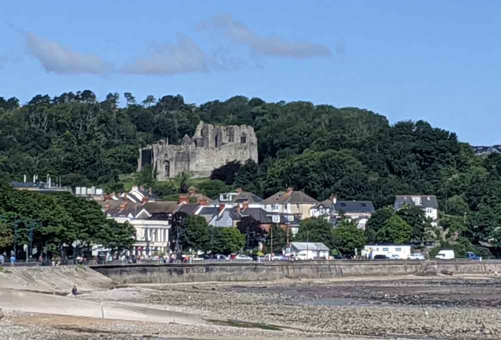 View of Mumbles Promenade with Oystermouth castle in background, Gower Peninsula, Wales