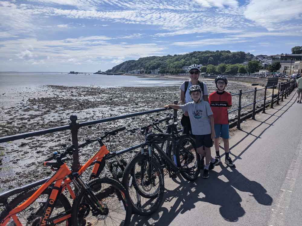 Family with bikes at Mumbles about to cycle to Swansea, Gower Peninsula, Wales