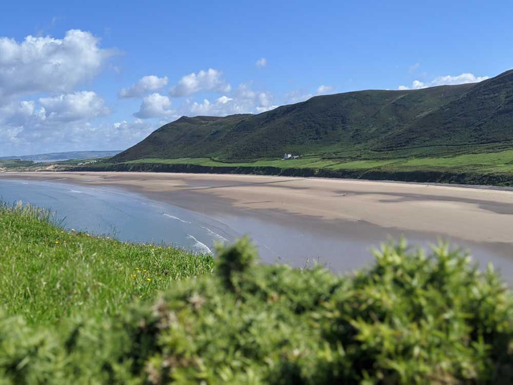 Looking back at Rhossili Bay Beach from cliffs, Gower Peninsula