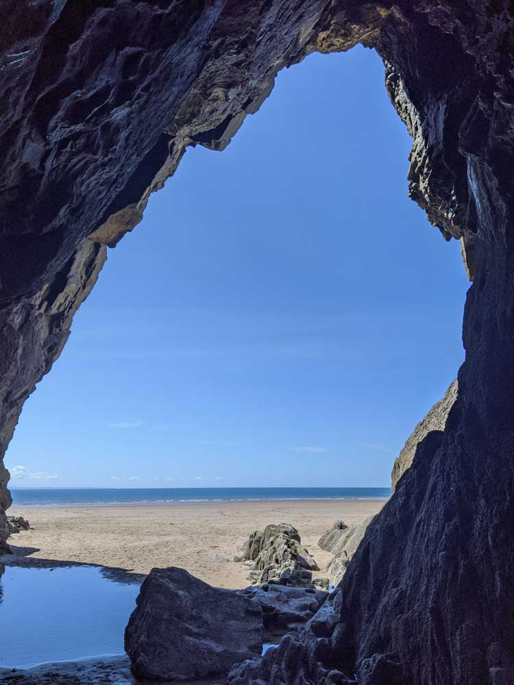 View of Three cliffs bay from cave, Gower Peninsula