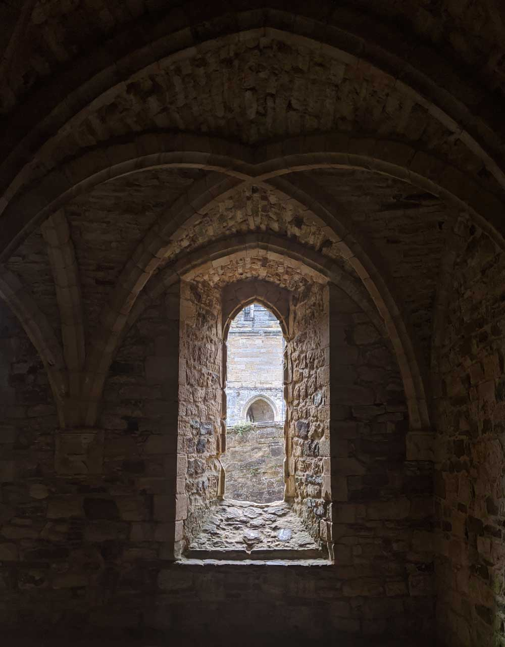 looking through stone window with Arched vaulted ceiling - Battle Abbey, Battle