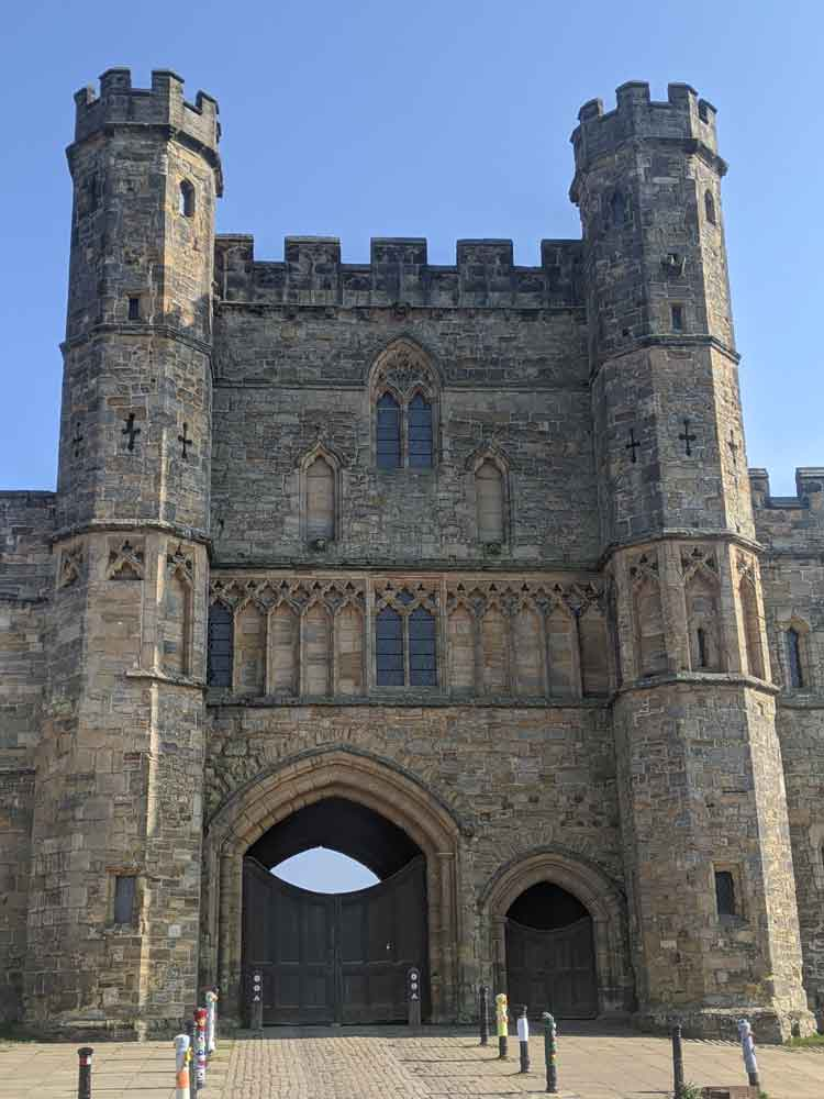 Large imposing Stone Gatehouse, flanked by two towers at Battle Abbey Gatehouse, Battle, Sussex, England