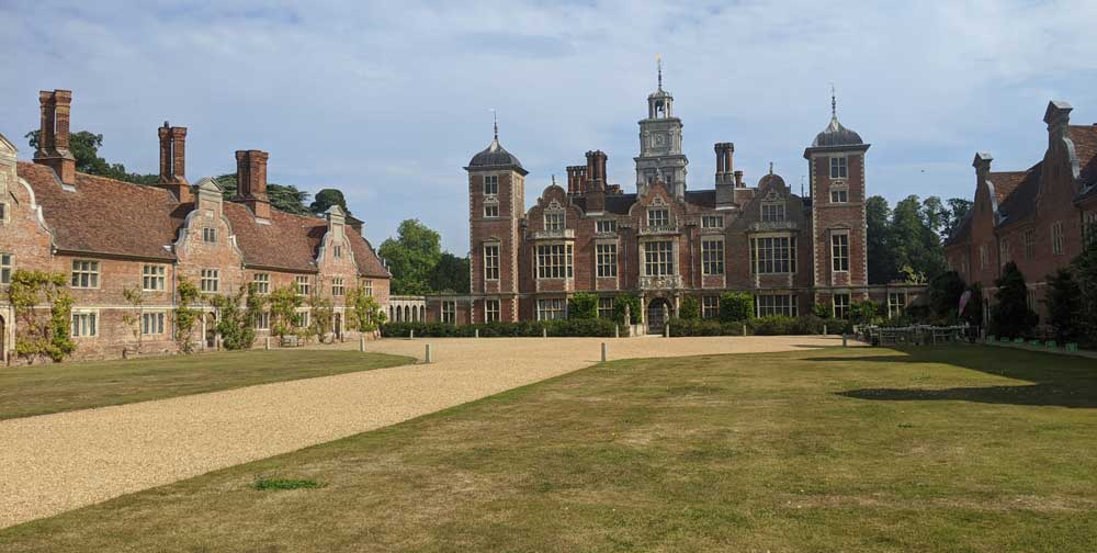 View of Blickling Estate buildings across manicured lawns and sweeping drive, Norfolk, England