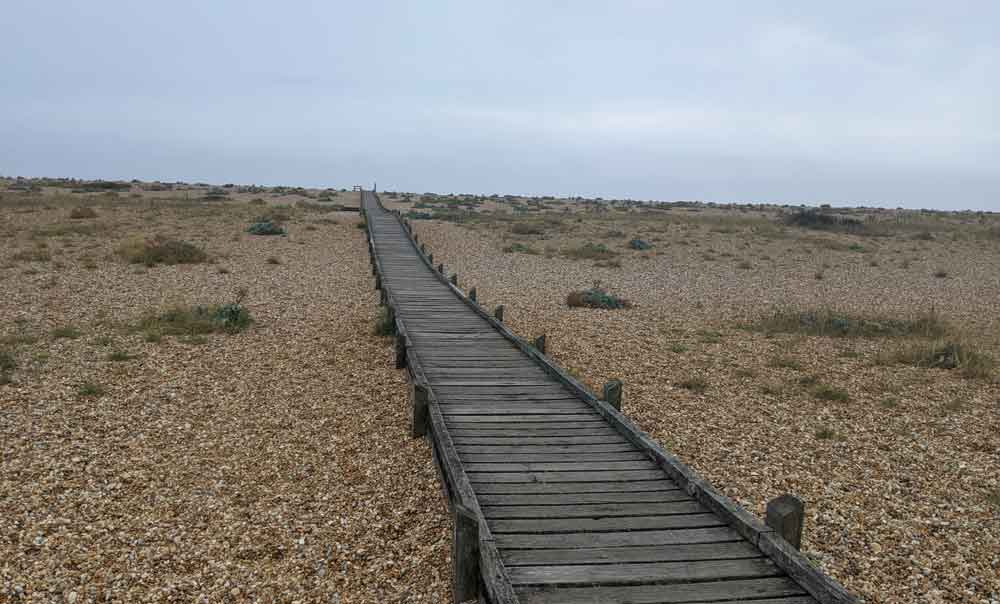 Boardwalk across shingle Beach, Dungeness, Kent, England