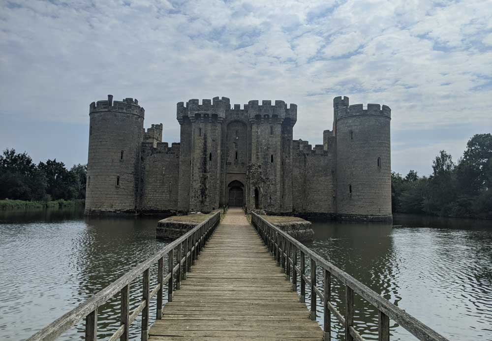 Wooden Walkway across moat to Bodium Castle, East Sussex, England