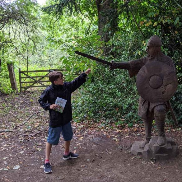 Small BoyChallenging a lifesize Norman Swordsman sculpture at Battle Abbey, Battle, Sussex