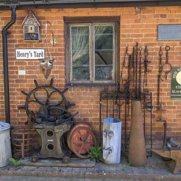 Tools and objects in front of Henry's Yard and Forge Rural Life Centre, Surrey