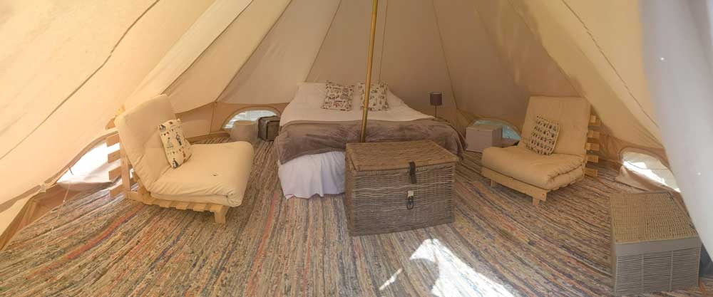 Large Bed and Interior of Brakes Coppice Bell Tent
