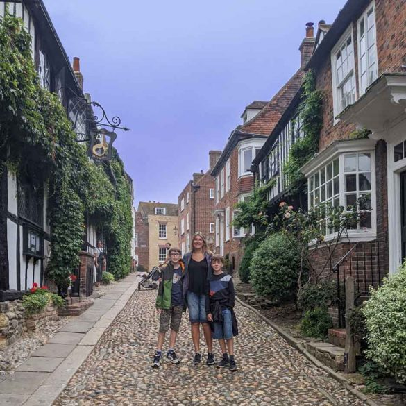 Family posing for picture, Mermaid Street, Rye, East Sussex, England