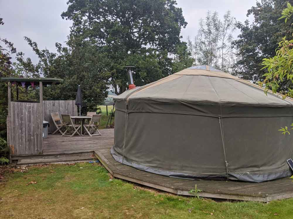 View of Owl Yurt its Kitchen and dining area at Freshwind Farm, Sussex