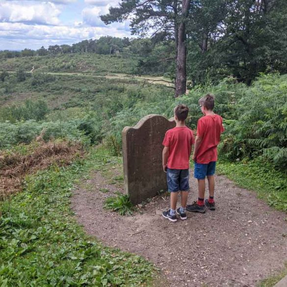 Two boys in front of the Sailors Stone, Devils Punchbowl