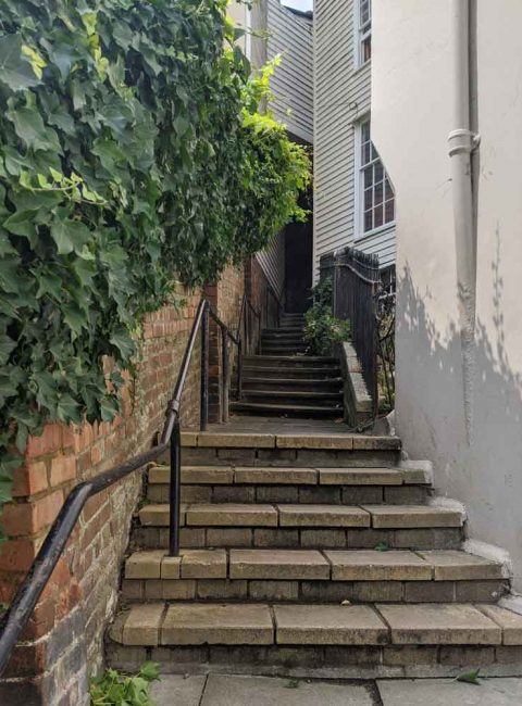 Steep Stairways between houses leading to Smugglers Adventure, Hastings, Sussex