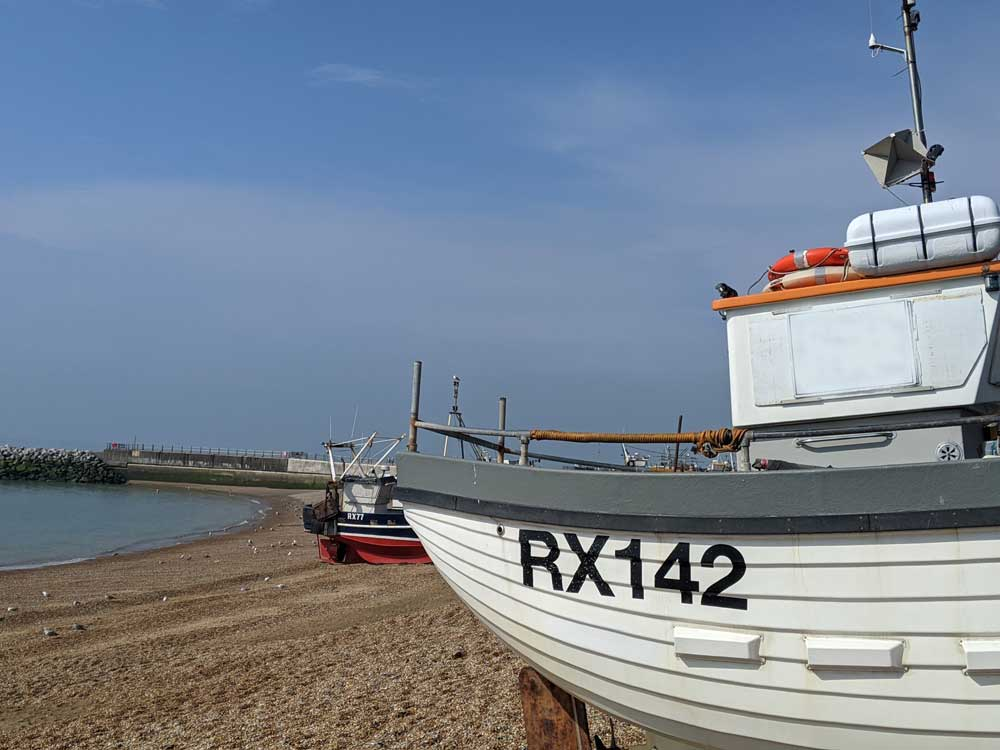 The Stade Fishing Boats pulled up onto shingle beach, Hastings, Sussex