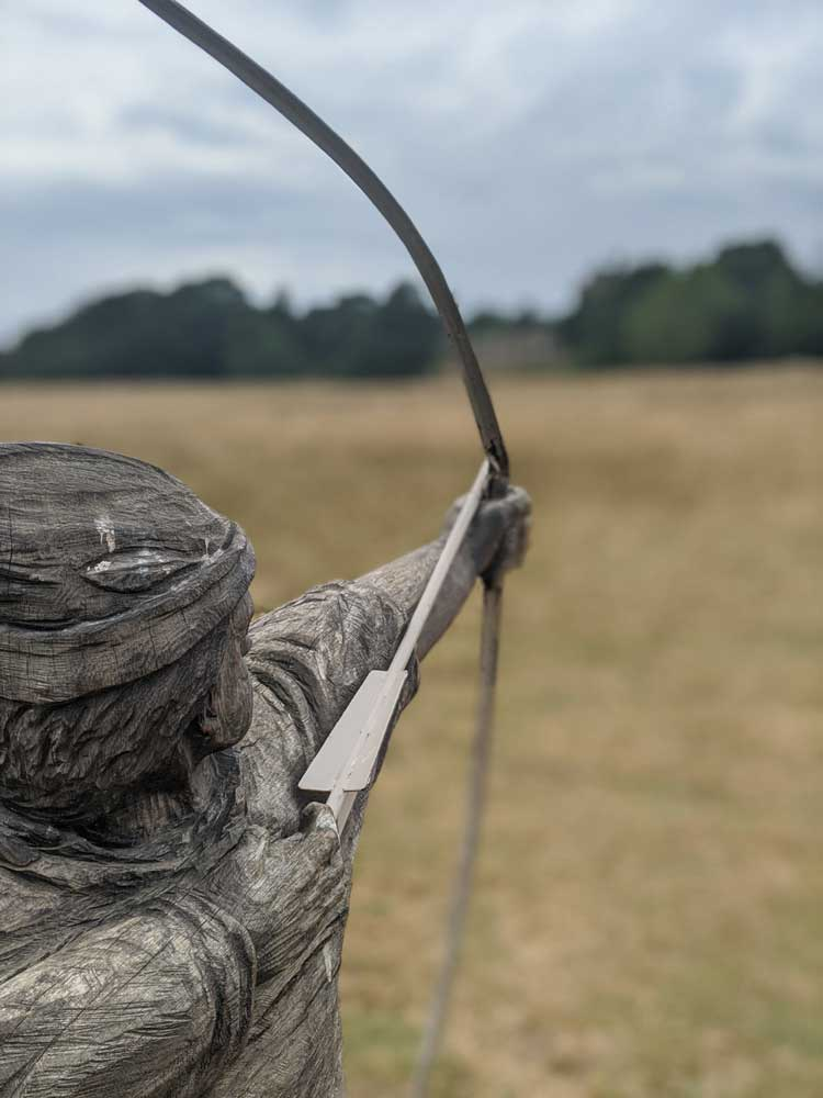 Wooden Archer statue drawing his bow, Battle of-Hastings, Battle, Sussex