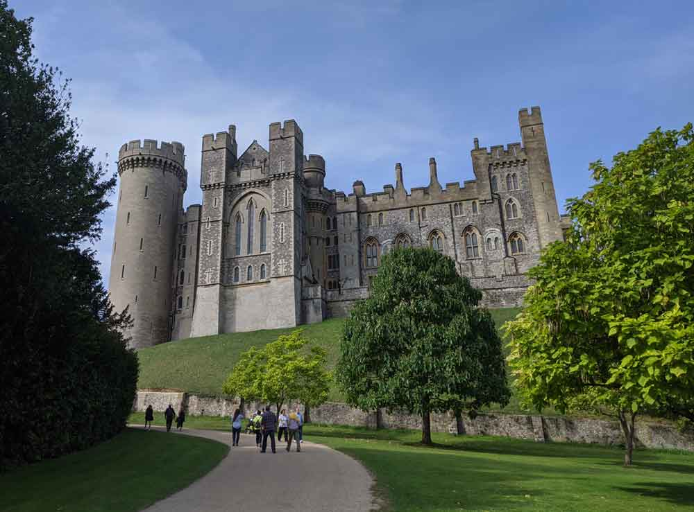 Looking up at imposing Arundel Castle from sweeping driveway
