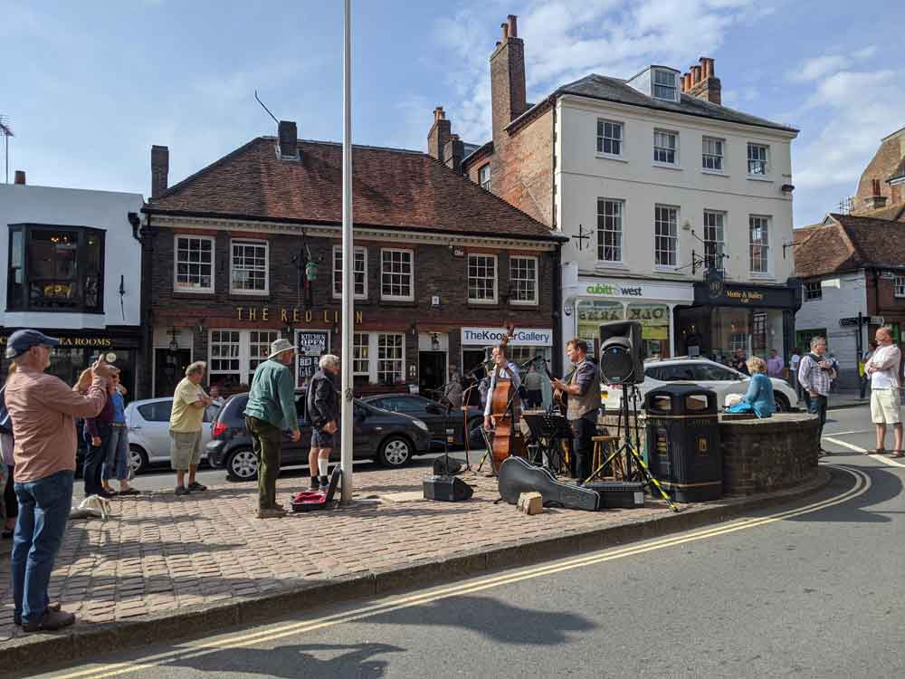 View of Arundel High Street with three piece band playing