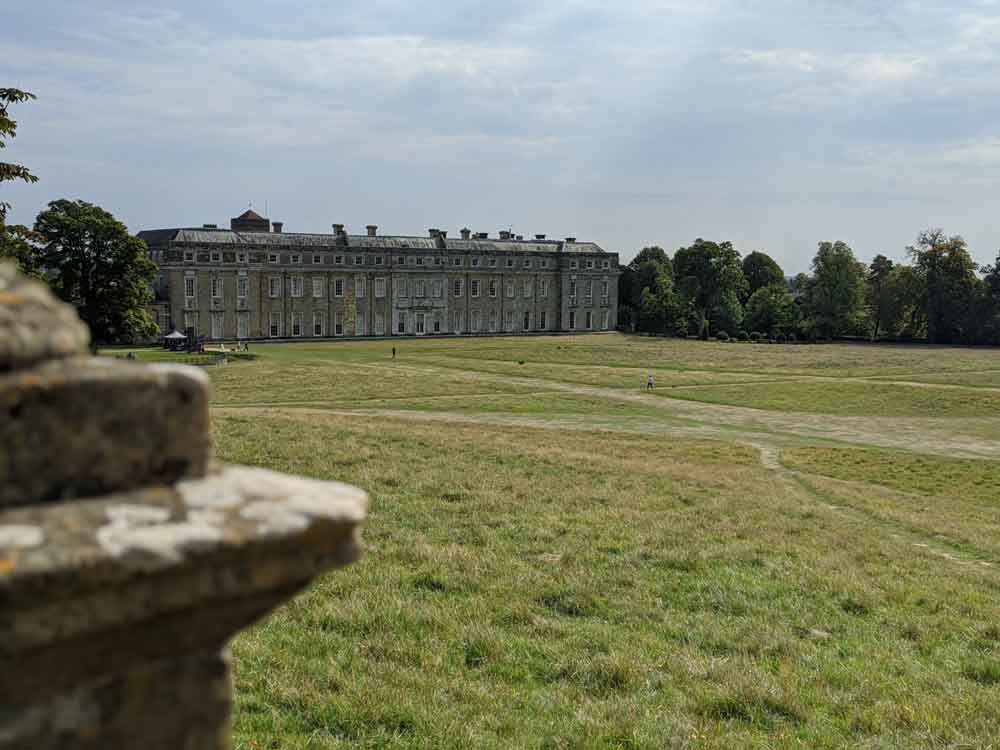 View of Petworth House and expansive lawns leading to deer park, Sussex