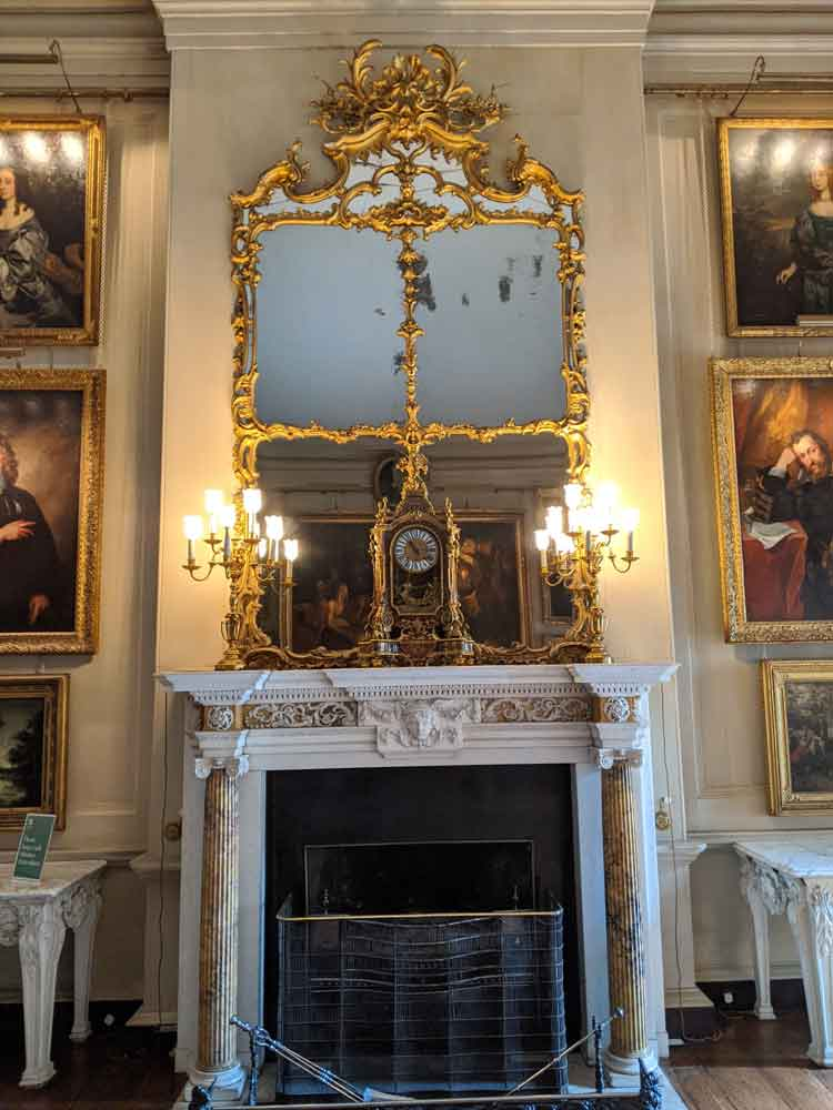 Petworth house Ornate Marble Fireplace and Gold trimmed mirror.