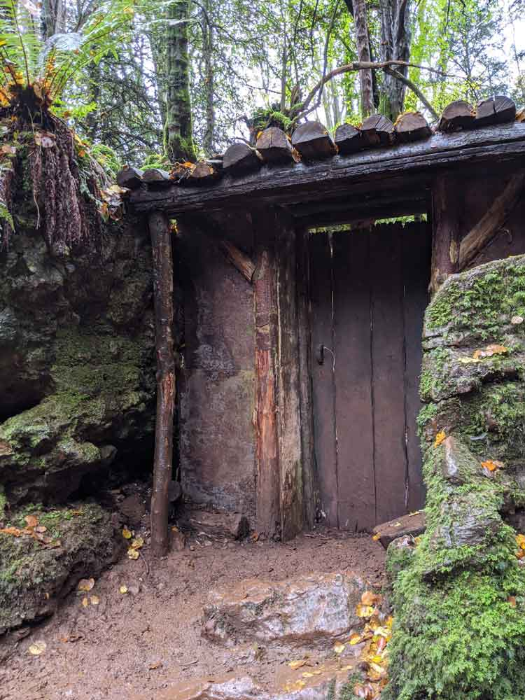Film set doors in woods, Puzzlewood. Coleford, Forest of Dean, UK