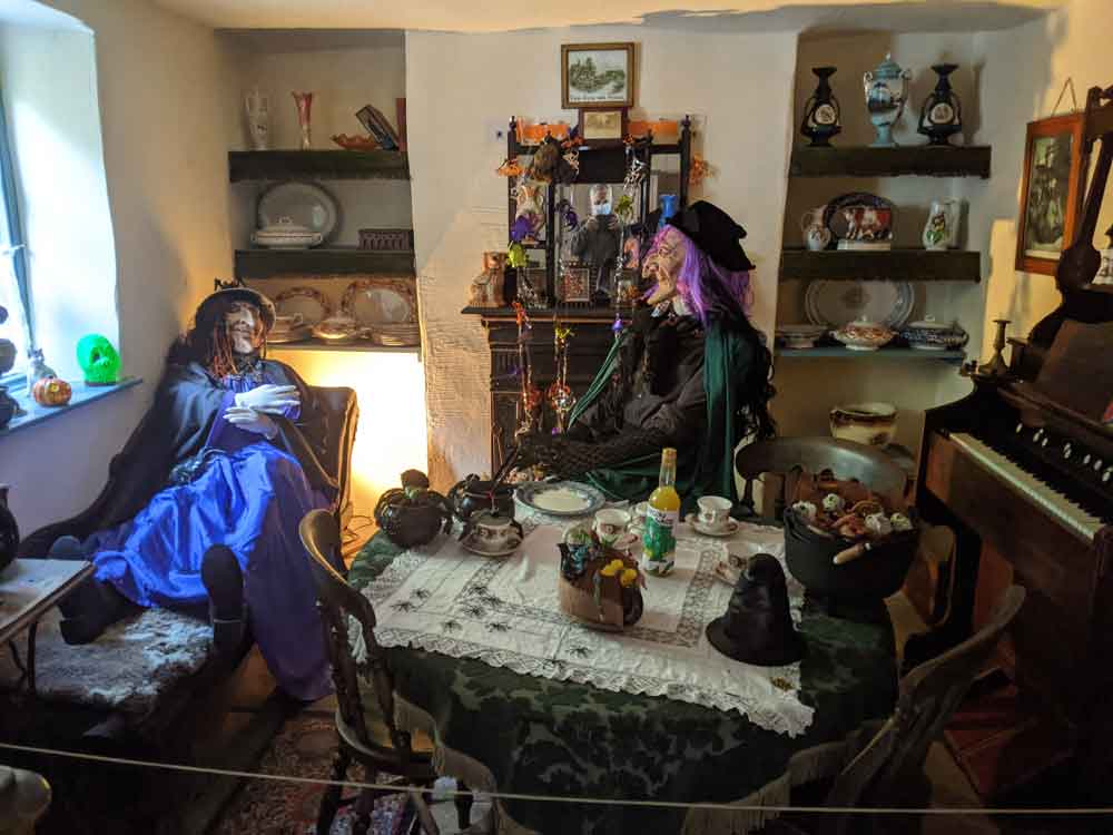 Two Halloween Witches at the Forester's Cottage, Dean Heritage Centre, Forest of Dean, Gloucestershire, UK