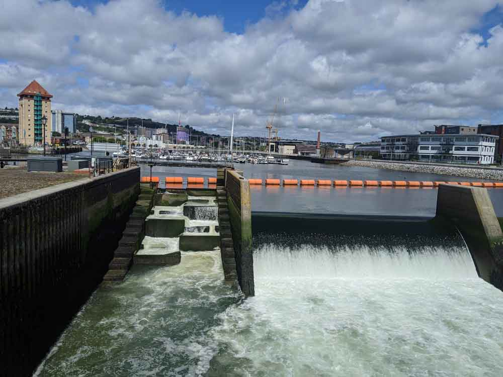 Cascading water at Tawe Barrage Lock Swansea, Wales, UK