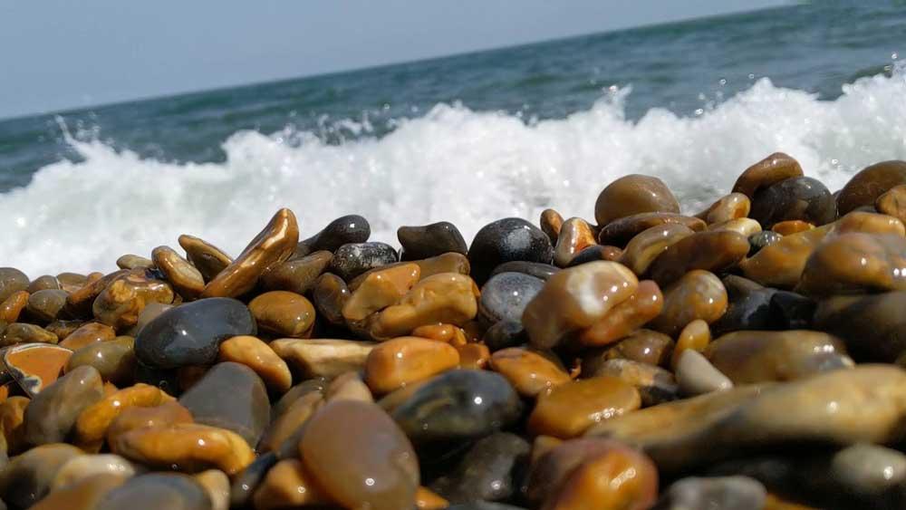 Wet Pebbles with sea crashing behind, Norfolk Beaches, Weybourne, Norfolk