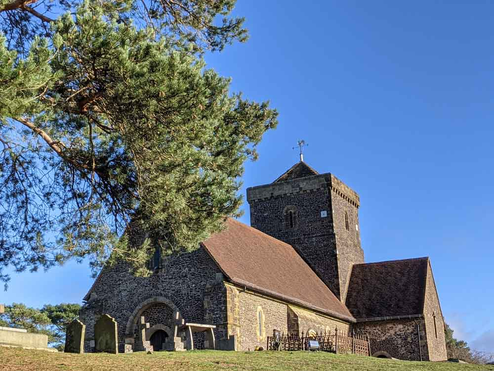 View of St Martha's Church, Surrey with blue sky backdrop, UK