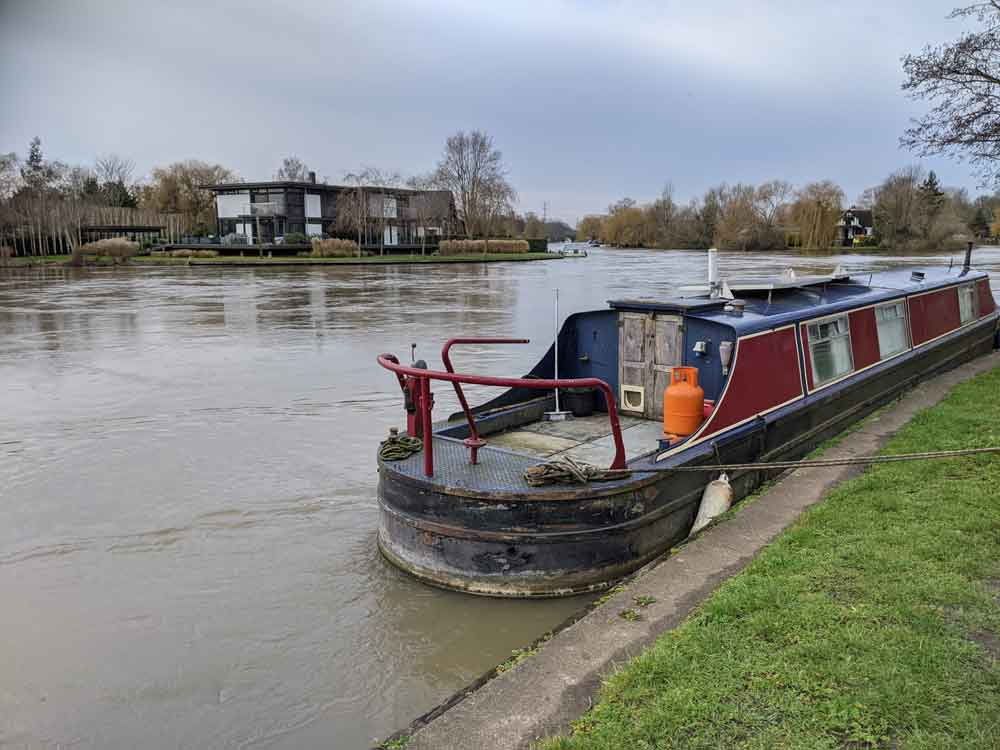 Canal boat with Pharoah's-island in background, Shepperton, Surrey, UK