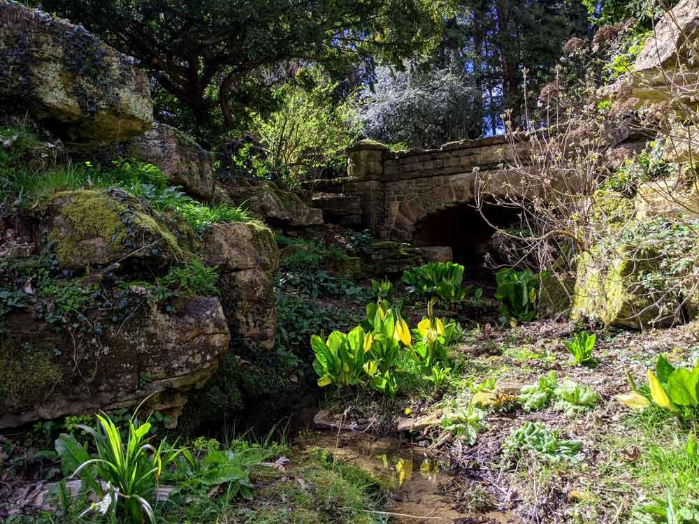 Bridge and river, Batsford Arboretum, Cotswold, UK