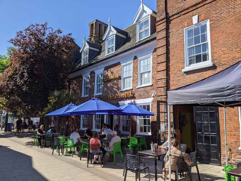 Eating in Beccles market square, Beccles, UK