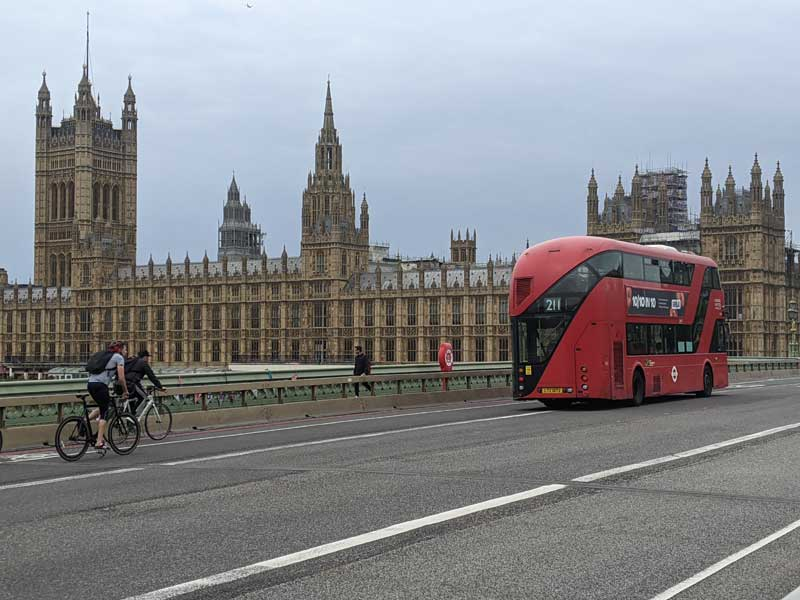 Red London Bus in front of Houses of Parliament , London, UK