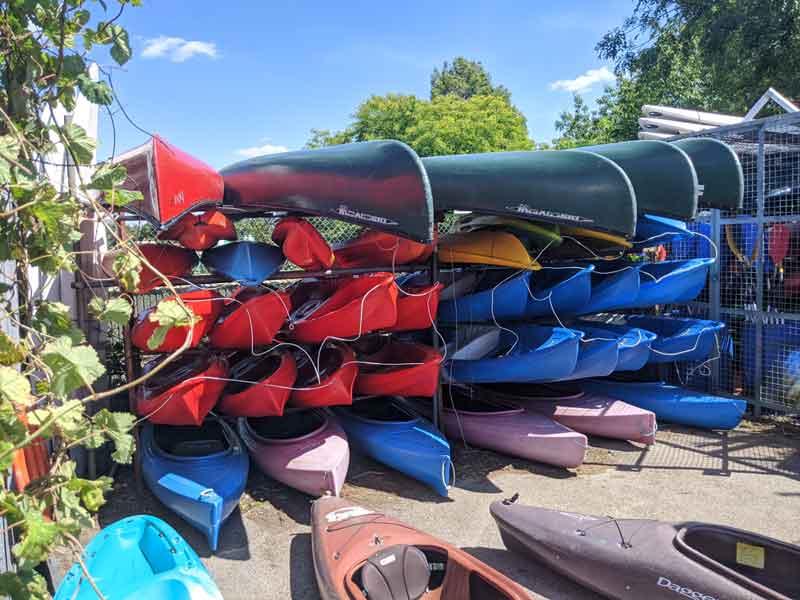 Canoes stacked at Wimbledon watersports, Wimbledon, UK